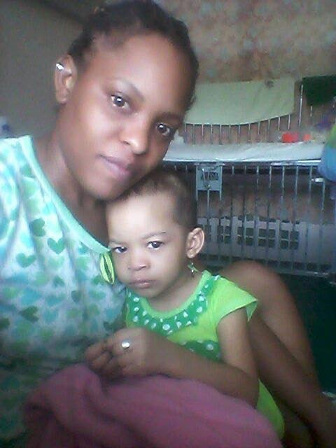 AT HOME: Asha David with her daughter Arabella Beharry who was discharged from Mt Hope Hospital on Tuesday and is now relaxing at home.