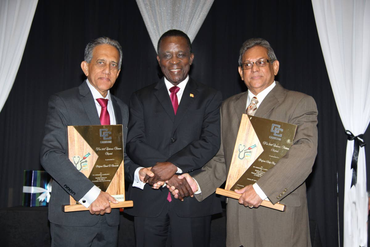 WINNERS: Grenada's Prime Minister Dr Keith Mitchell with Trinis Prof Dalip Ragoobirsingh, right, and Prof Samuel Ramsewak, winners of the Caricom science award. PHOTO BY SUREASH CHOLAI