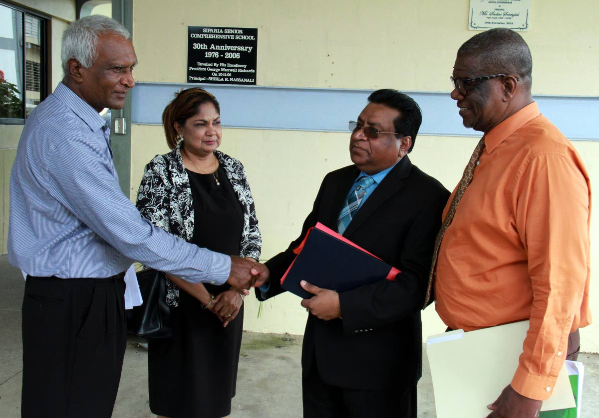 At left, Siparia West Secondary School principal Sookoo Sonnylal greets at center, Chief Education Officer Harrilal Seecharan while second left, School Supervisor III Zabeedah Hosein - Abid and at right, Act Director of School Supervision John Thompson looks on. PHOTO BY ANIL RAMPERSAD.