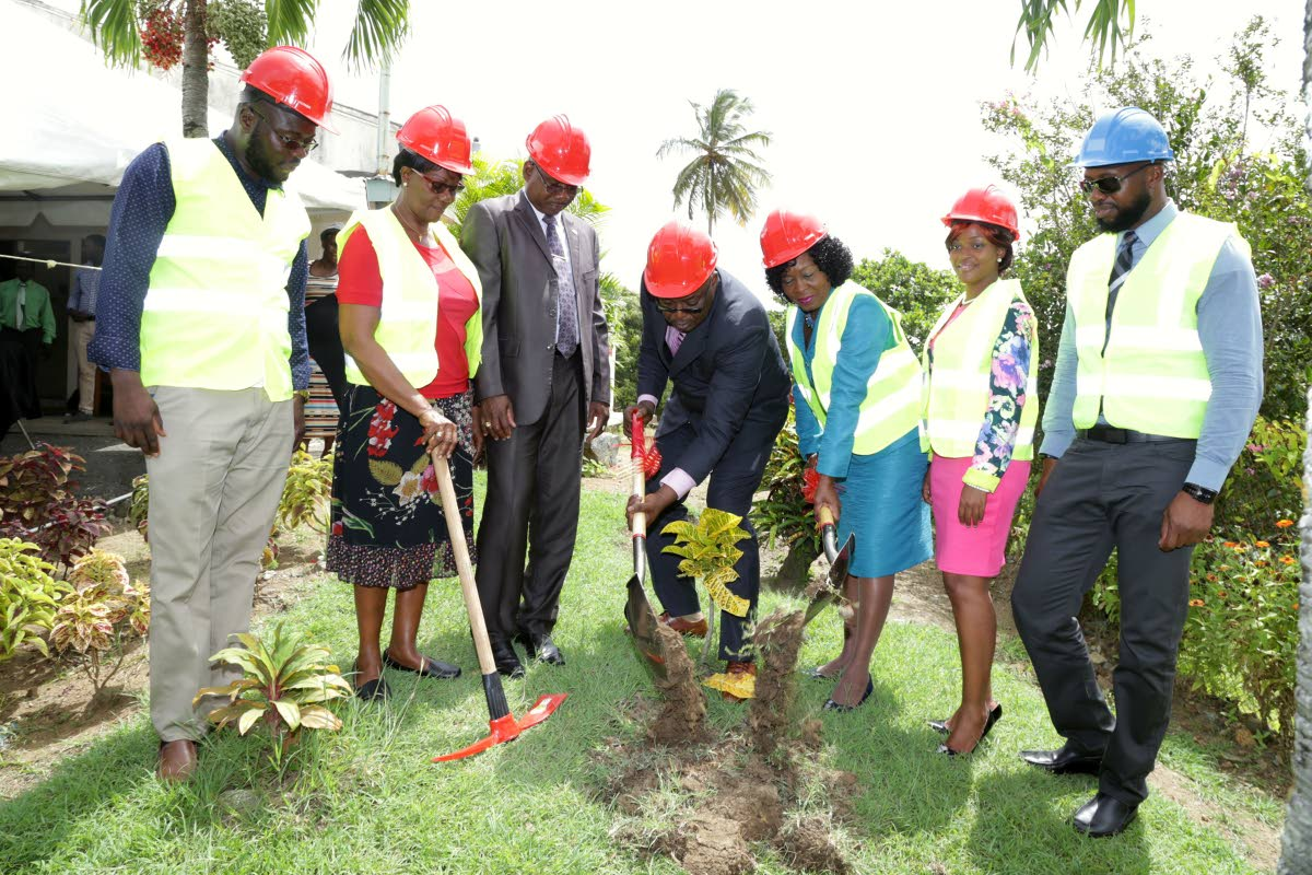 Tobago House of Assembly Chief Secretary Kelvin Charles, centre, turns the sod along with Secretary for the Division of Community Development, Enterprise Development, and Labour Marslyn Melville- Jack, to mark start of construction of the Belle Garden Multipurpose Facility on September 26. Others in photo, from left, are the Division's building maintenance service coordinator Neil Alleyne, president of the Belle Garden Village Council Pearl Beache, area representative and Secretary of the Division of Food Production, Hayden Spencer, MTS director Rosanna McKenna and manager of Protran (1997) Ltd, contractors on the project, Kenneth Dates