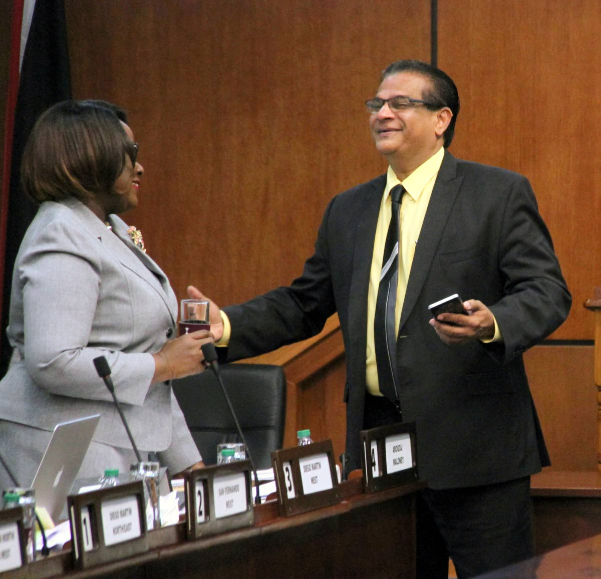 Minister of Planning Camille Robinson-Regis and Member of Parliament for San Juan/Barataria Faud Khan share a light moment during the budget debate yesterday. PHOTO BY SUREASH CHOLAI.
