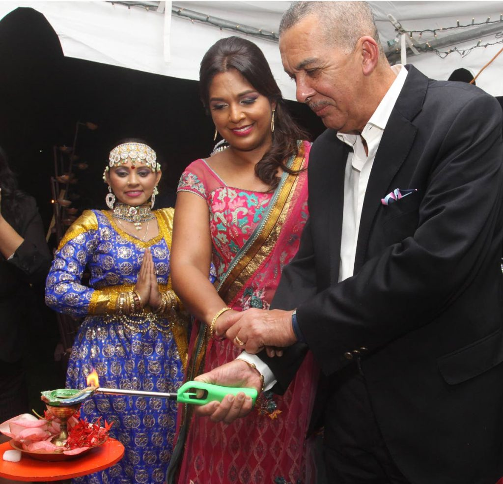 President Anthony Carmona and his wife Reema, light the first deya at his Divali Celebrations, President's Grounds, St. Anns. PHOTO BY ANGELO MARCELLE