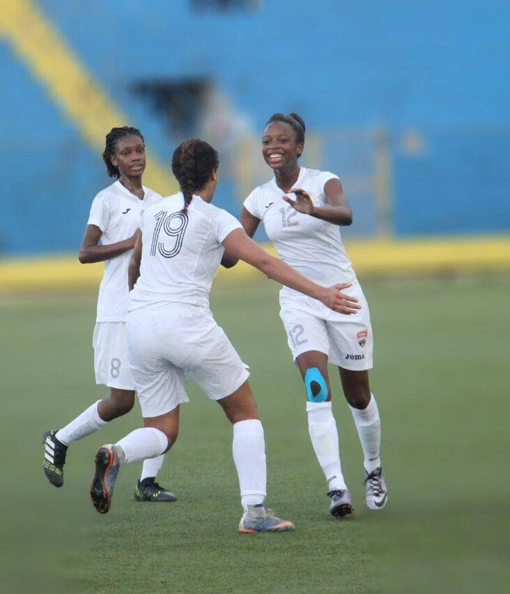 Sarah De Gannes (centre) is congratulated by her TT teammates Aaliyah Pascall (right) and Nataifha Hackshaw after scoring against Bermuda on Monday. PHOTO COURTESY TT FOOTBALL ASSOCIATION.