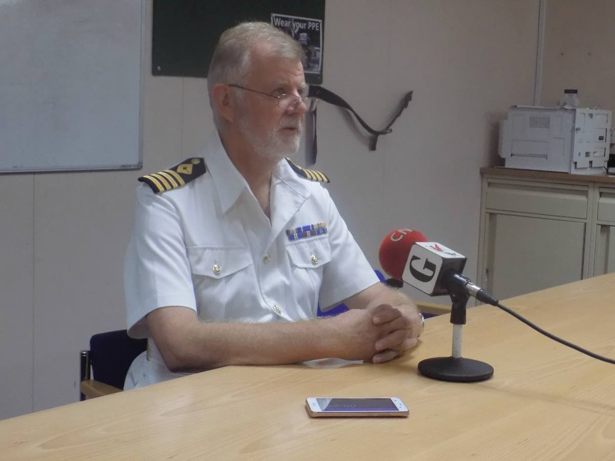 Commanding Officer of the RFA Mounts Bay, Captain Stephen Norrisspeaks with reporters after a brief tour of the vessel which provided aid in the wake of Hurricane Maria in Dominica.