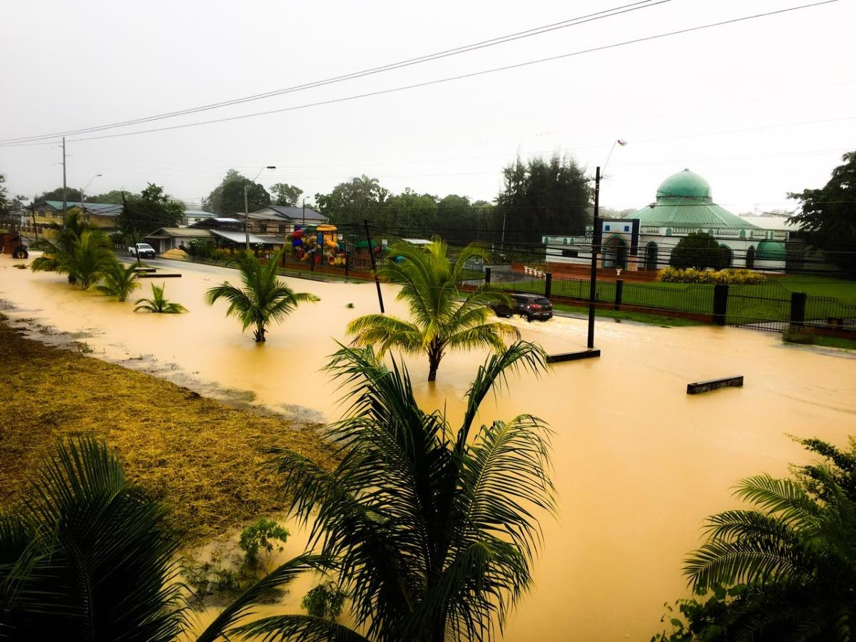 WATER EVERYWHERE: This photo, posted on social media yesterday, shows brown water covering all of Rochard Road in Barrackpore as large sections of Trinidad saw widespread flooding following heavy showers which started on Wednesday.
