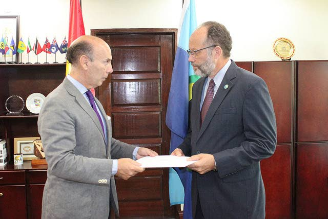Javier Maria Carbajosa, ambassador of Spain to Caricom, presents his letter of credence to Ambassador Irwin LaRocque, Caricom secretary general.