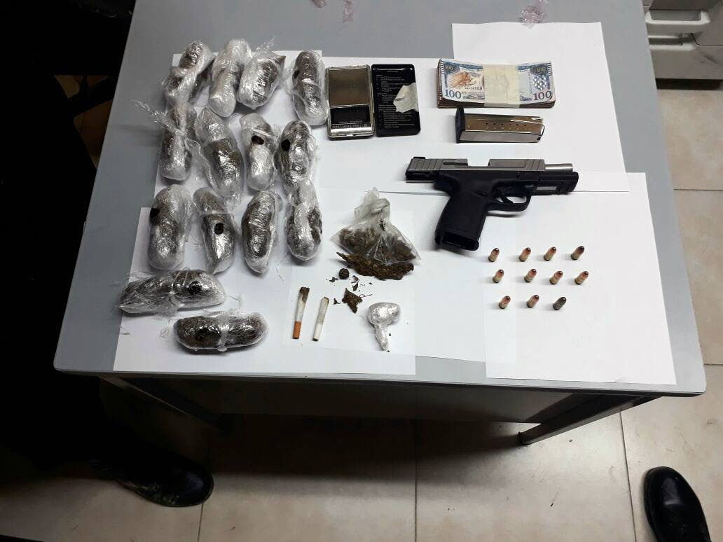 SEIZED: A pistol, ammunition, compressed marijuana and money believed to be the proceeds from the sale of illegal drugs, were seized by Eastern Division police who also arrested two men yesterday.