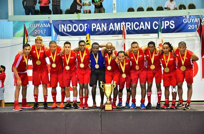 Members of the Trinidad and Tobago men's hockey team with their silverware after clinching the 2017 Indoor Pan Am Hockey Cup on Saturday. PHOTO COURTESY GUYANA CHRONICLE.
