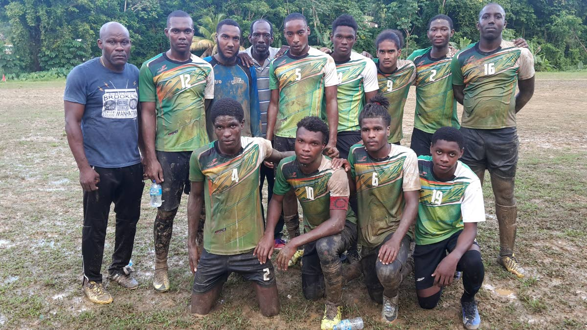 Members of Manzan United FC pose with their management team after booking their spot in the semi-finals of the Caribbean Welders Fishing Pond Football League.