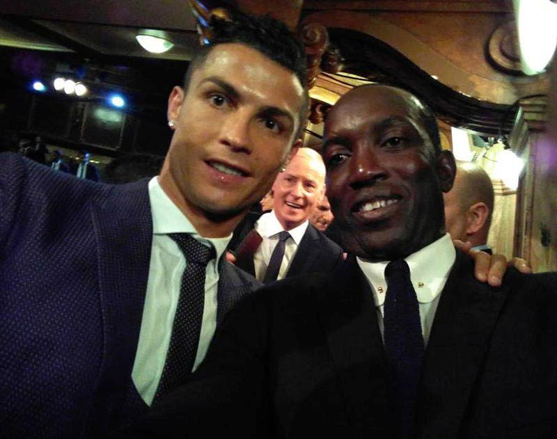 Dwight Yorke, right, takes a selfie with The Best FIFA Men's Player Cristiano Ronaldo at the FIFA Awards yesterday in London.