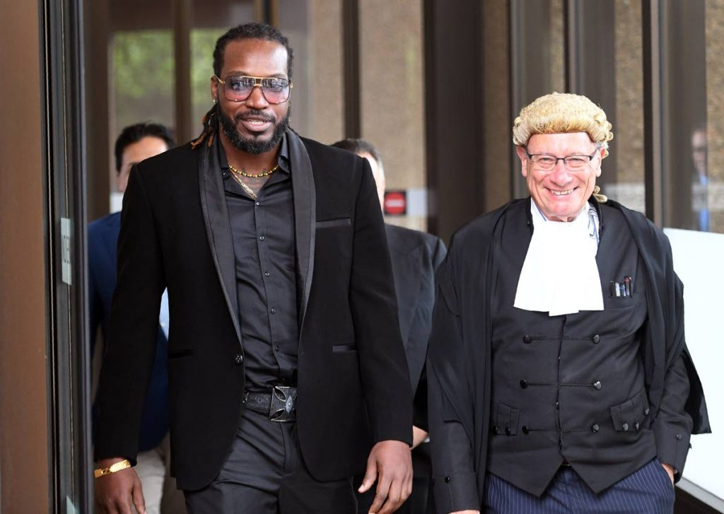 West Indies cricketer Chris Gayle, left, leaves the New South Wales Supreme Court in Sydney on Wednesday.