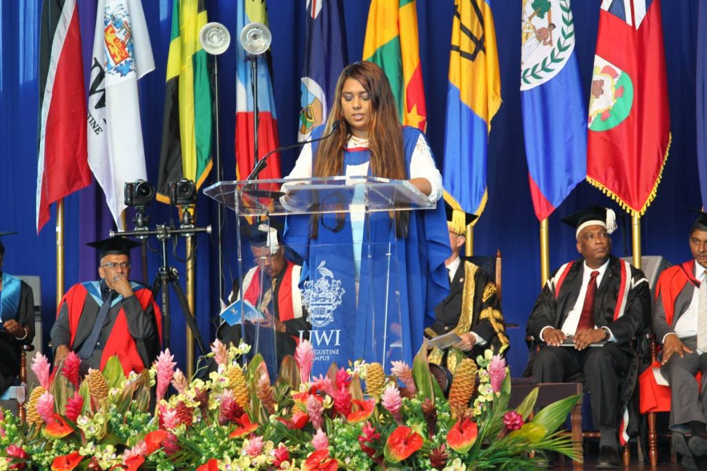 Karisa Krystal Bridgelal, who recently participated in Newsday's Youth Lens and Opinions education project, delivers the valedictory address on the final day of UWI  graduation ceremonies yesterday.