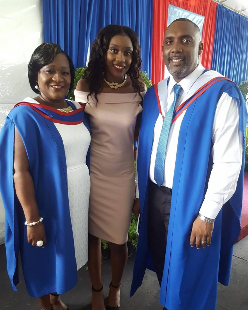 Winner of an Additional scholarship for Natural Sciences, Bishops High School student Phia Rochford, centre, poses for a photo with her parents, Corinne and Phillip Rochford at their graduation last Saturday at the University of the West Indies, St Augustine. Mr and Mrs Rochford graduated with Masters degrees in Educational Leadership.