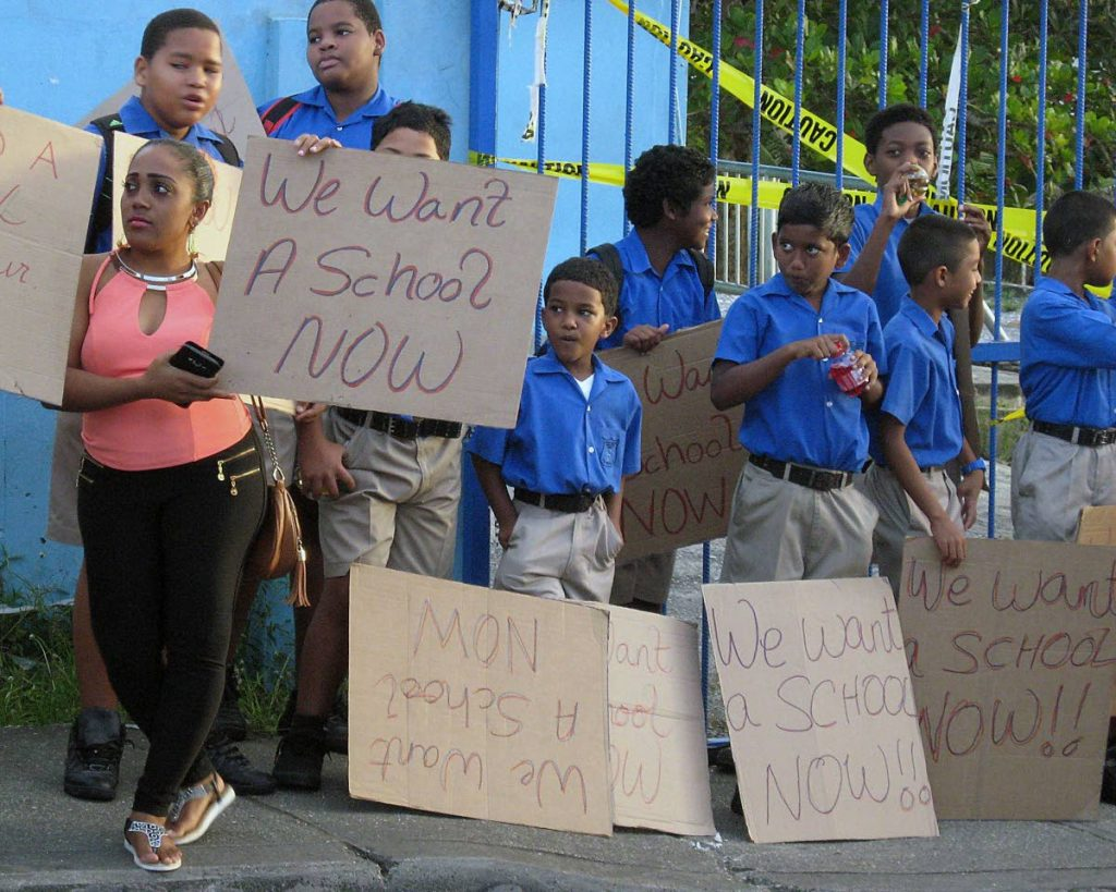 Students protest outside the Sangre Chiquito Primary Presbyterian school in February this year. The existing school has been deemed unfit for occupation.