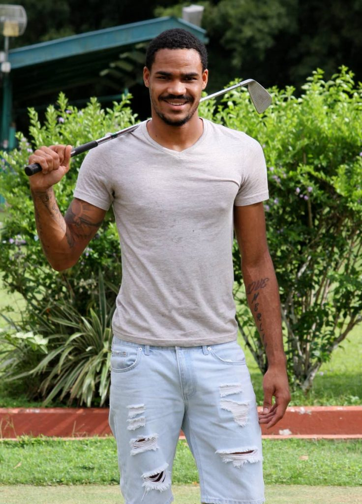 National footballer Alvin Jones poses with a golf club during a recent interview at the Chaguaramas Golf Course.