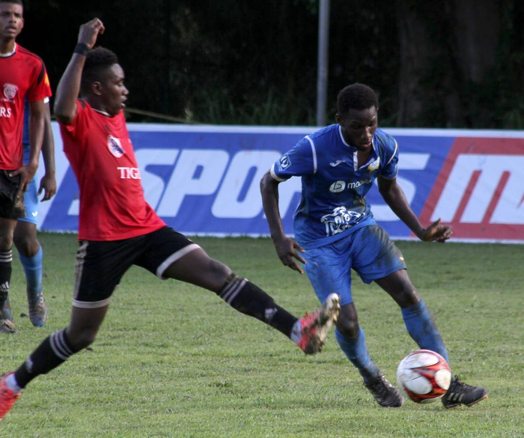 Presentation College's Darnell Hospedales, right, in action against  St Anthony's College in Secondary Schools Football League action recently.
