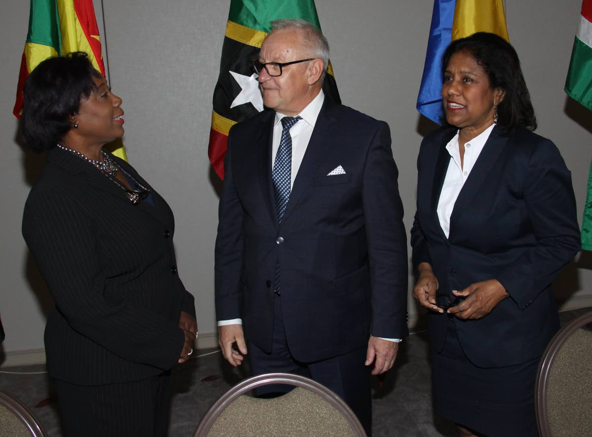 Trade and Industry Minister Paula Gopee-Scoon, right, listens as House Speaker Bridgid Annisette-George makes a point to European Parliament member Boleslaw Piecha yesterday at an EU-Cariforum Parliamentary Committee meeting at the Hyatt Regency in Port of Spain.