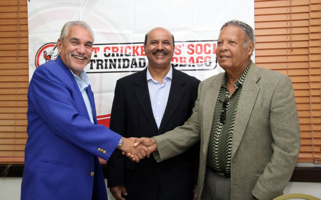Past Cricketers Socety members Colin Murray, left, Alvin Corneal, right, and Justice Prakash Moosai, centre, chat at the launch of the 2nd annual Cricketers Can Cook at the Queen's Park Oval, yesterday.
