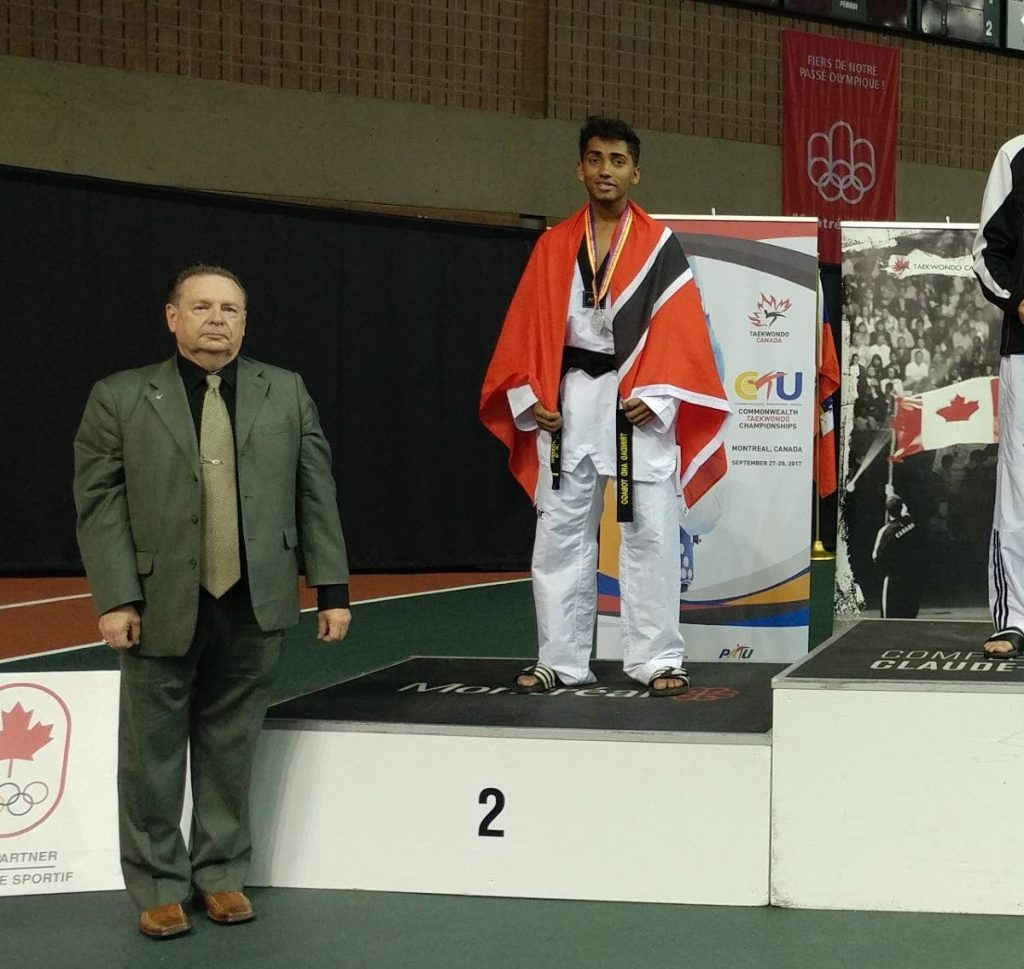 Brandon Joseph stands proudly with the TT flag after copping a silver medal at the 2017 Commonwealth Taekwondo Championship Games in Canada.