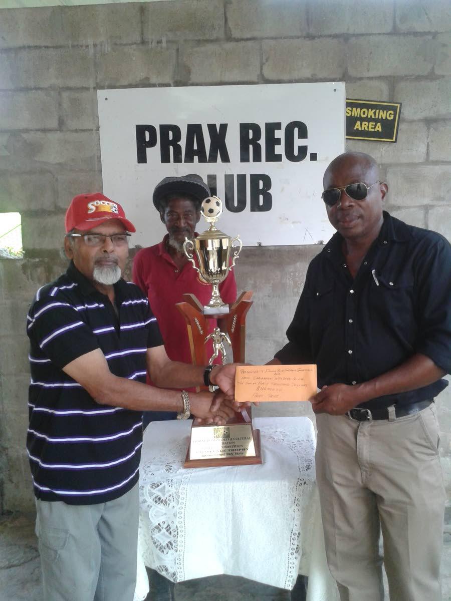 Fishing Pond Football League organiser Prakash Ramkissoon, left, poses with league sponsor Peter Park, Managing Director of Caribbean Welders.