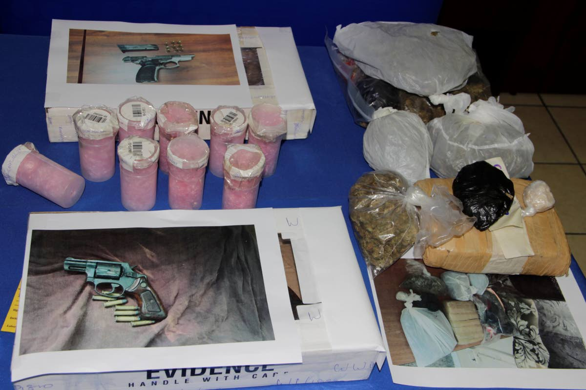 Two guns, and a haul of ammunition and illegal drugs, recovered by police officers in Tobago, are on display at the Scarborough Police Station at a press briefing on Wednesday.