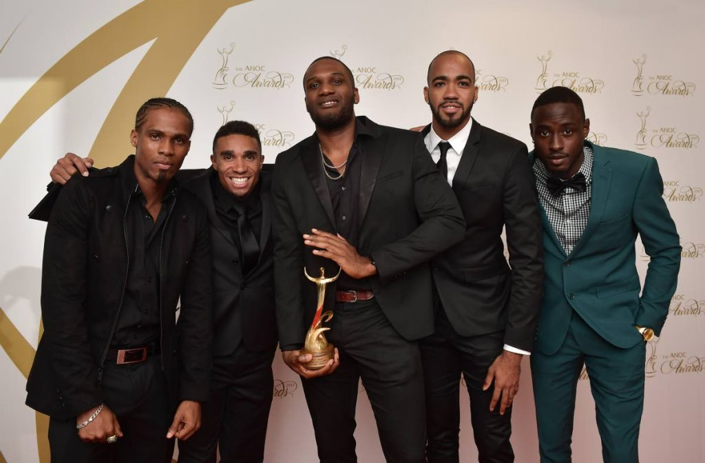 AMERICAS' BEST: Trinidad and Tobago's 4x400 World Championship gold medallists (from right) Jereem Richards, Machel Cedenio, Lalonde Gordon and Jarrin Solomon are joined by teammate Renny Quow, left, after they won the Best Male Atletes of the Americas at the Association of National Olympic Committee (ANOC) Awards in Prague.