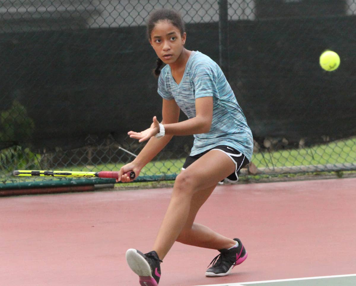 Emily Lawrence playing at the Subway Junior Tennis Championship, Trinidad Country Club, Maraval. Her opponent was Aralia Blackman. PHOTO BY ANGELO M. MARCELLE
