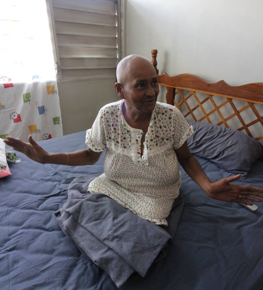 I good: Amputee Erica Joseph is grateful yesterday for the apartment she and her husband now have at Charford Court, Charlotte Street, Port-of-Spain after living under a tent at Queen's Park Savannah recently. Photo by Roger Jacob