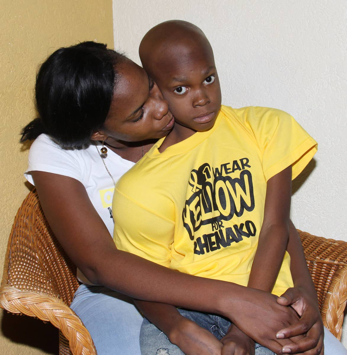 HOPE: Cancer patient Rhenako Beard, 10, and his mother,Tenisha Elder. PHOTO BY ANGELO MARCELLE.
