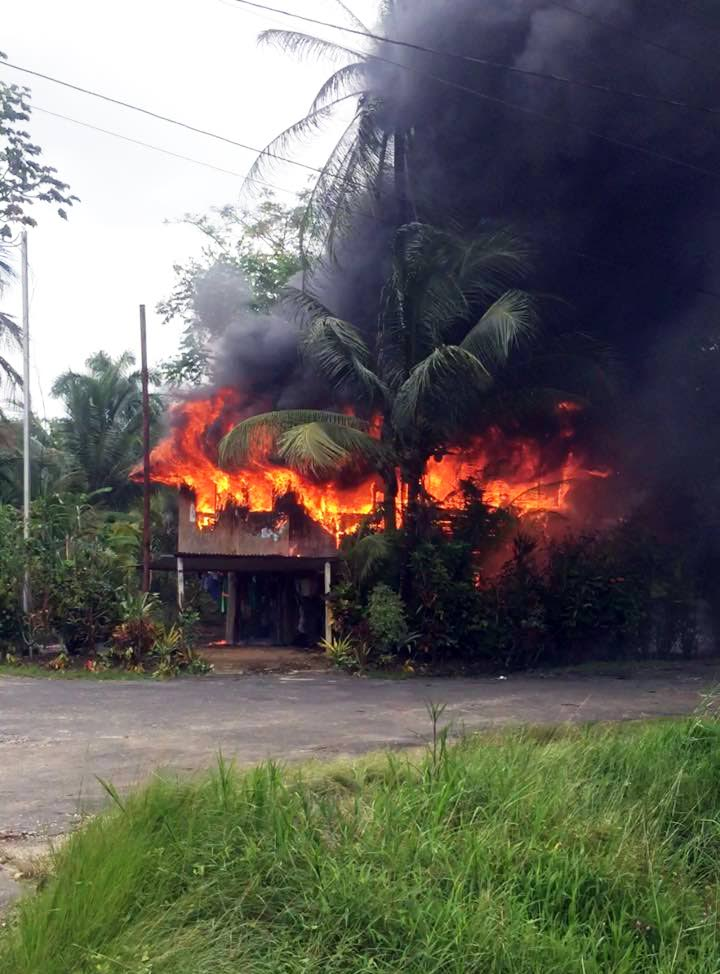 ON FIRE: The burning house at Bristol Village, Mayaro, from which four men rescued four children.