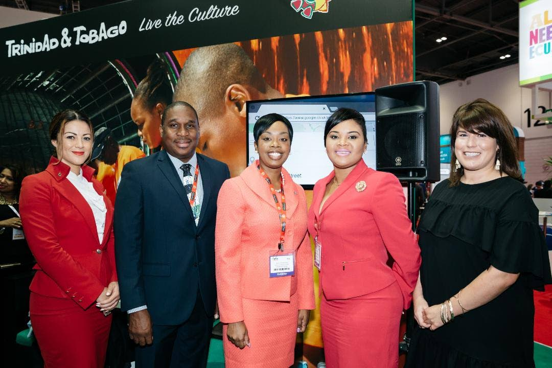 Tourism Minister Shamfa Cudjoe, second from right, and Tourism Secretary Nadine Stewart-Phillips, third from right, ose for a photo with, from left, a representative from Virgin Atlantic, Louis Lewis, Chief Executive Officer, Tobago Tourism Agency, and Lizzy Davis, Content Creator, Virgin Atlantic at the World Travel Market 2017 in London on Monday.