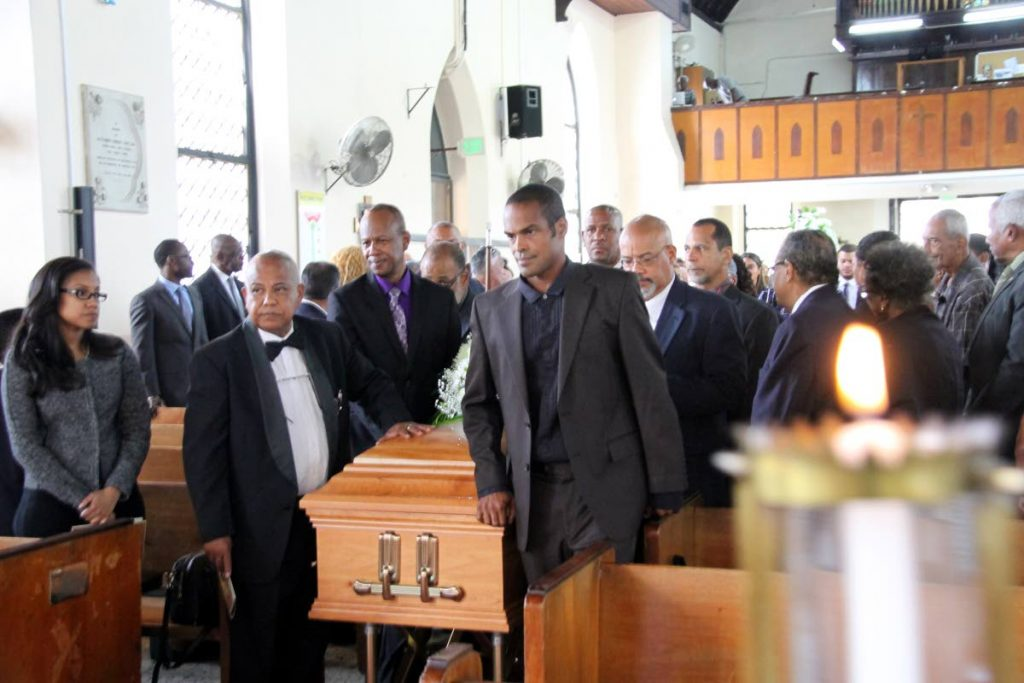 Final passage: The casket of Bruce Procope QC is taken out of All Saints Anglican Chruch, Port of Spain after his funeral yesterday. Photo by Sureash Cholai.