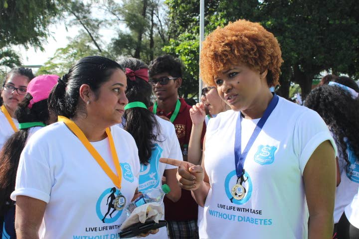 Talk after walk: Minister of Community Development, Culture and the Arts  Dr Nyan Gadsby-Dolly chats with a participant after a walkathon hosted by St Augustine Girls' High School yesterday. Photo by Steffon Douglas
