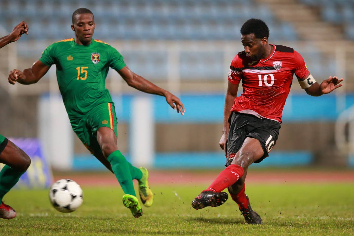 Trinidad and Tobago captain Kevin Molino, right, shotts to score a stoppage time equaliser against Grenada in an international friendly on Saturday at the Ato Boldon Stadium, Couva. The match ended 2-2. Photo: Allan V. Crane/CA-images.