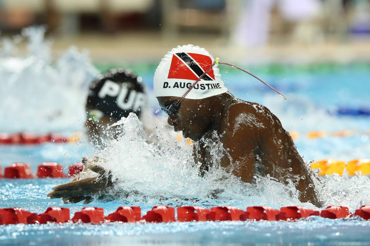 Derelle Augustine during his gold medal swim in the Boys 11-and-Over 100-metre breastroke B final on Sunday. PHOTO BY ALLAN CRANE/CA-IMAGES