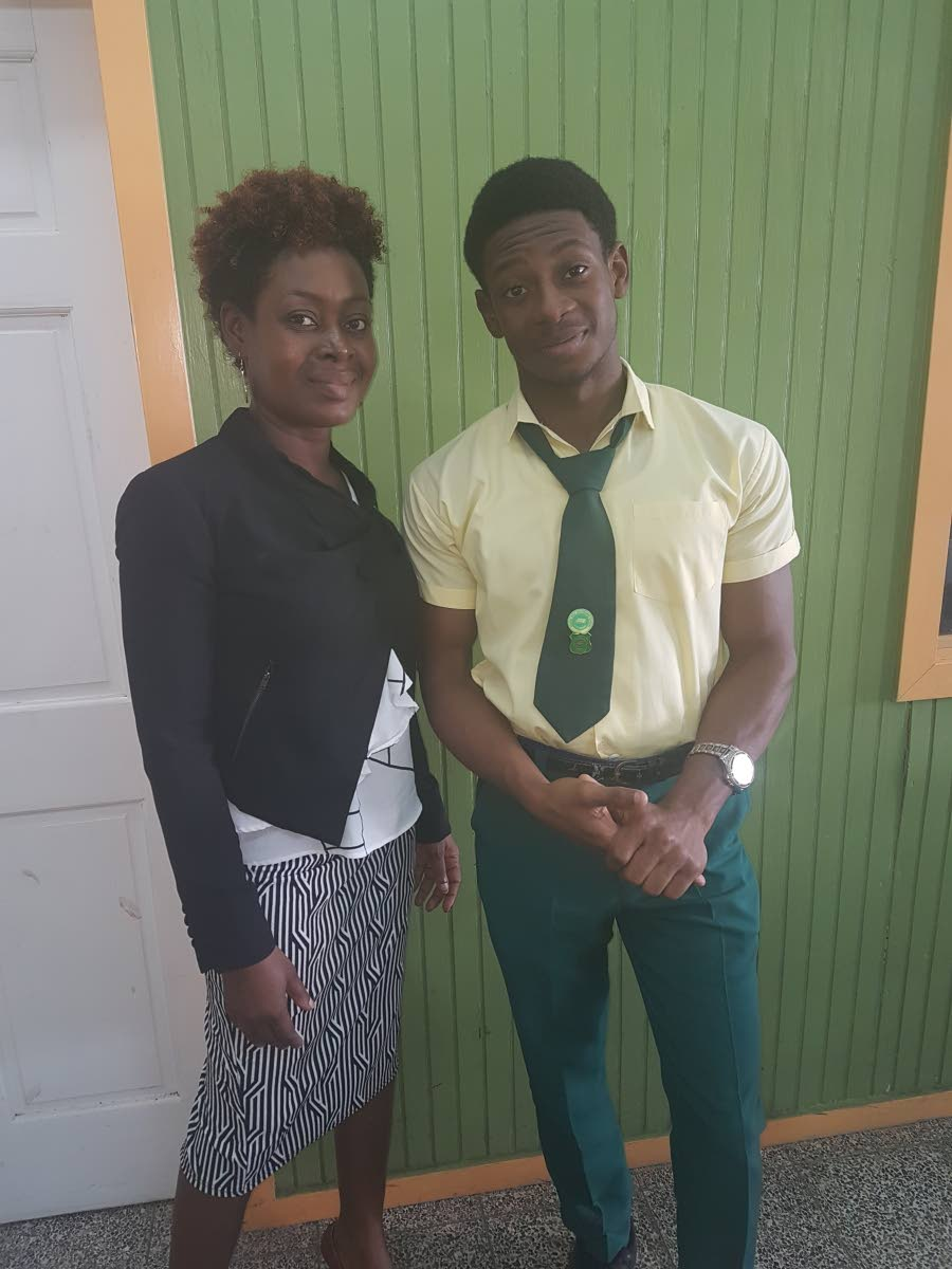 Signal Hill Secondary student, Kemeul Henry Abraham, who placed fourth in the Caribbean in CAPE Level 1 Building and Mechanical Engineering Drawing at CAPE, shares a moment with his mother, Stacy Abraham, who is also his teacher for this subject, at the school on Monday.
