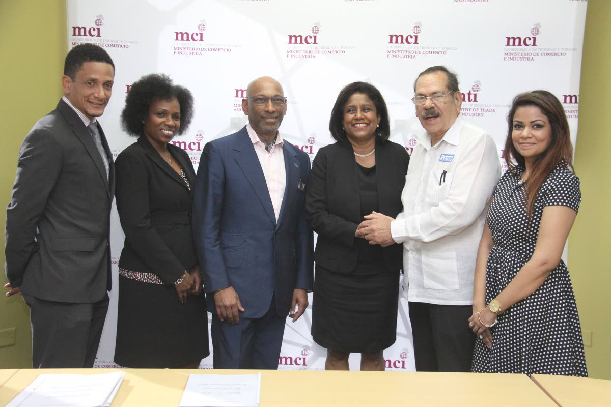 Fashion TT Chairman, Jason Lindsay, TT Creative Industries Company Director, Dionne McNicol Stephenson,  Founder of the Savile Row Academy, Master Tailor and Director of Maurice Sedwell, Professor Andrew Ramroop OBE, Minister of Trade, Paula Gopee-Scoon,  MIC Institue of Technology Chairman, Professor Clement Imbert and  Lisa-Marie Daniel of Fashion TT, at the  launch of the Certificate Programme in Ultra Bespoke Tailoring,  Level 16, Nicholas Towers, Port of Spain.  PHOTO:ANGELO M. MARCELLE 15-11-2017