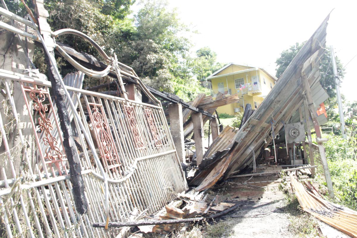 Remains of a house which was destroyed by fire on Monday at Eboe Gully, Crown Trace, Les Coteaux.