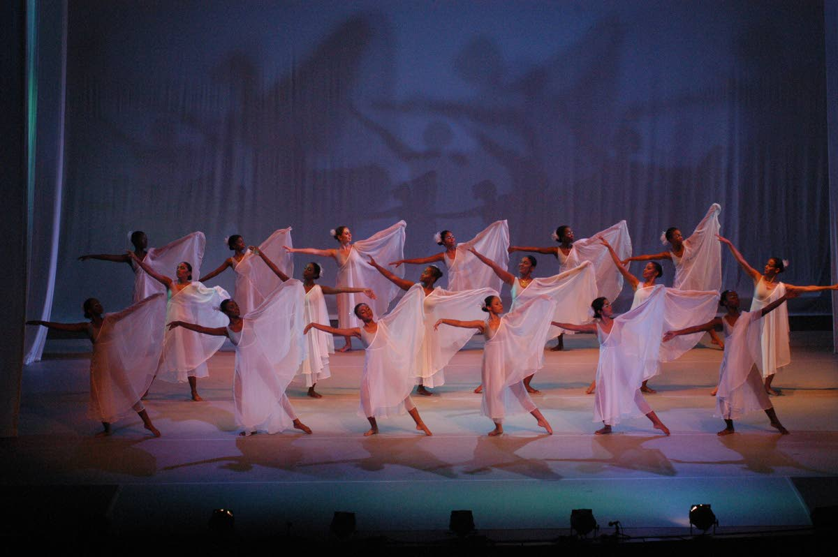 Students of Caribbean School of Dancing perform a piece choreographed by Patricia Roe at Fantasy in Dance '03. Photo courtesy Caribbean School of Dancing.