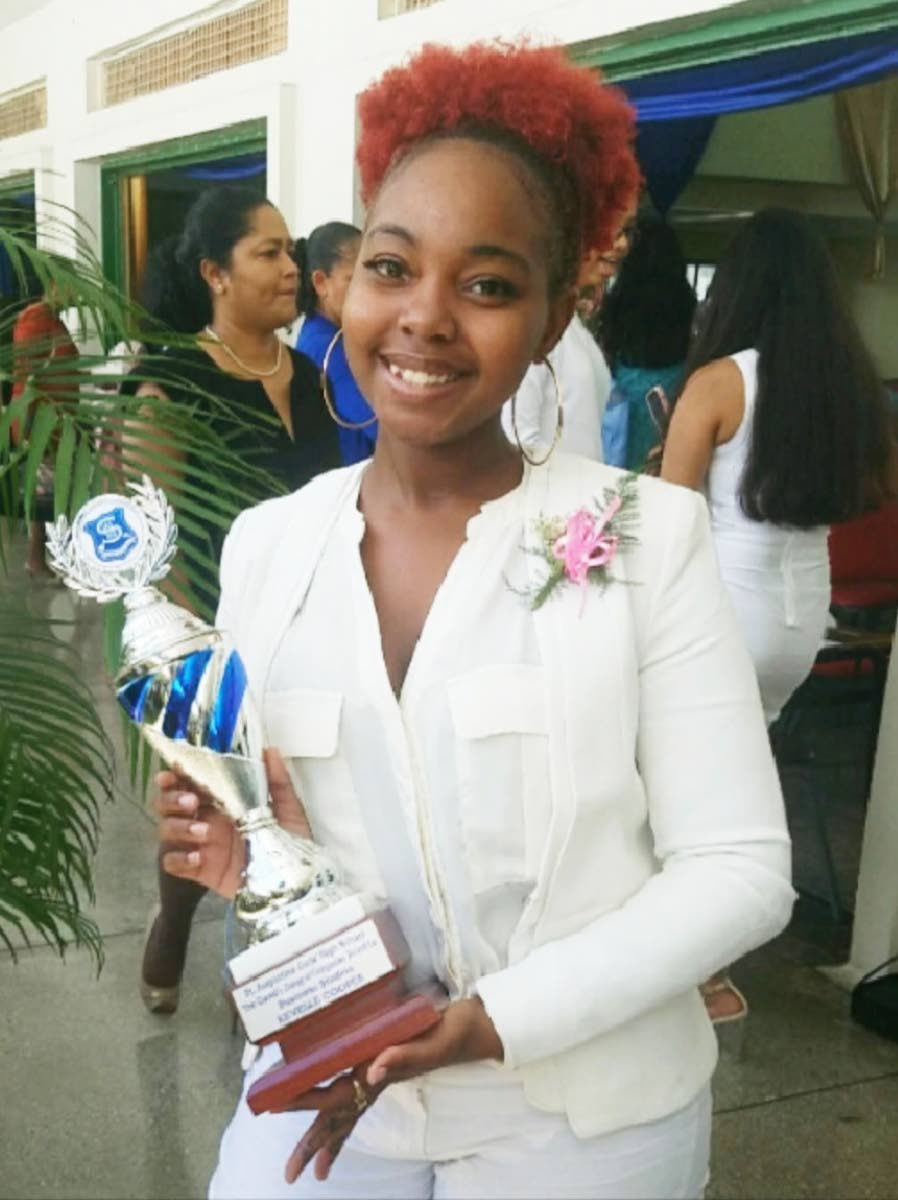 Major achievement: Scholarship winner Kevelle Cooper and her award on her graduation from St Augustine Girls' High School.