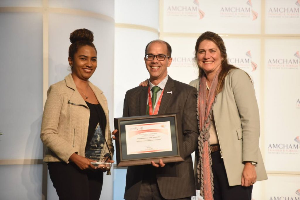 2017 winners of AmChamTT's HSE Awards: Gail Figaro Regional HSE Manager, Massy Technologies Applied Imaging accepting the award for Outstanding HSE Project: Services to the Energy Sector - Medium from Mitchell De Silva, President AmChamTT and Catalina Herrera Roca Vice President AmChamTT. PHOTO COURTESY AMCHAMTT.