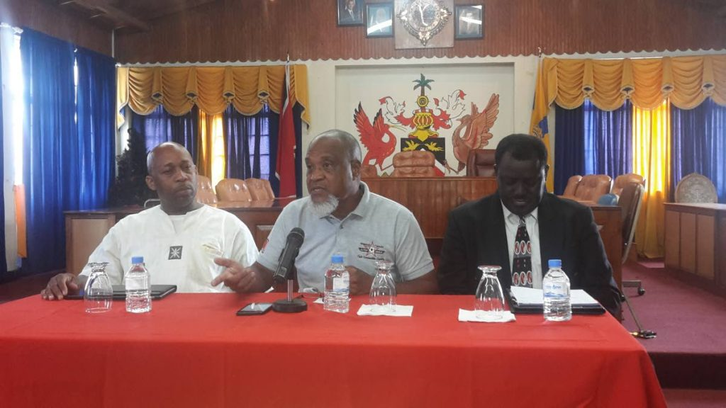 Keith Look Loy, centre, coach of FC Santa Rosa, makes a point at a press conference yesterday at Arima Town Hall. He is flanked by Clynt Taylor, left, general secretary of the Central Football Association, and Selby Browne, president of the Veteran Footballers Organisation of Trinidad and Tobago.