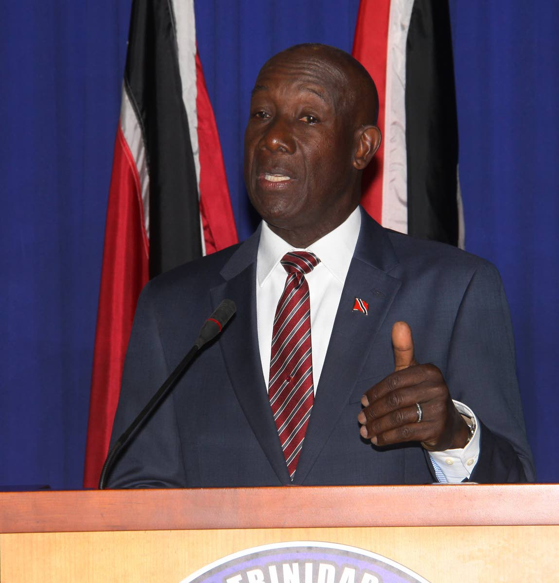 WARNING: Prime Minister Dr Keith Rowley speaking at yesterday's news conference at the Office of the Prime Minister in St Clair.  PHOTO BY ANGELO M MARCELLE