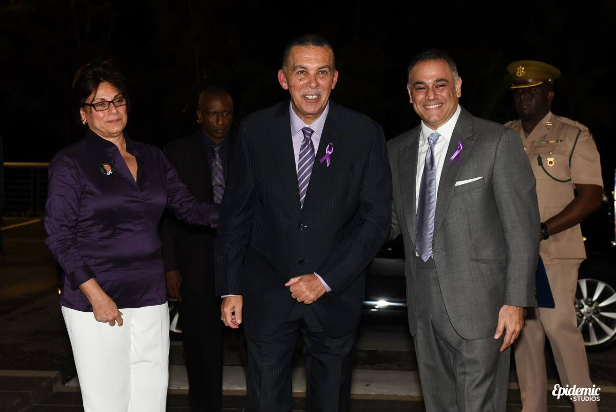 Natalie Sabga escorts President Anthony Carmona to the launch of the John E Sabga Foundation for Pancreatic Cancer at Prime Restaurant, Port of Spain on November 16. At right is Peter George, chairman of the foundation's board. PHOTO COURTESY SCOTT  MCDONALD.