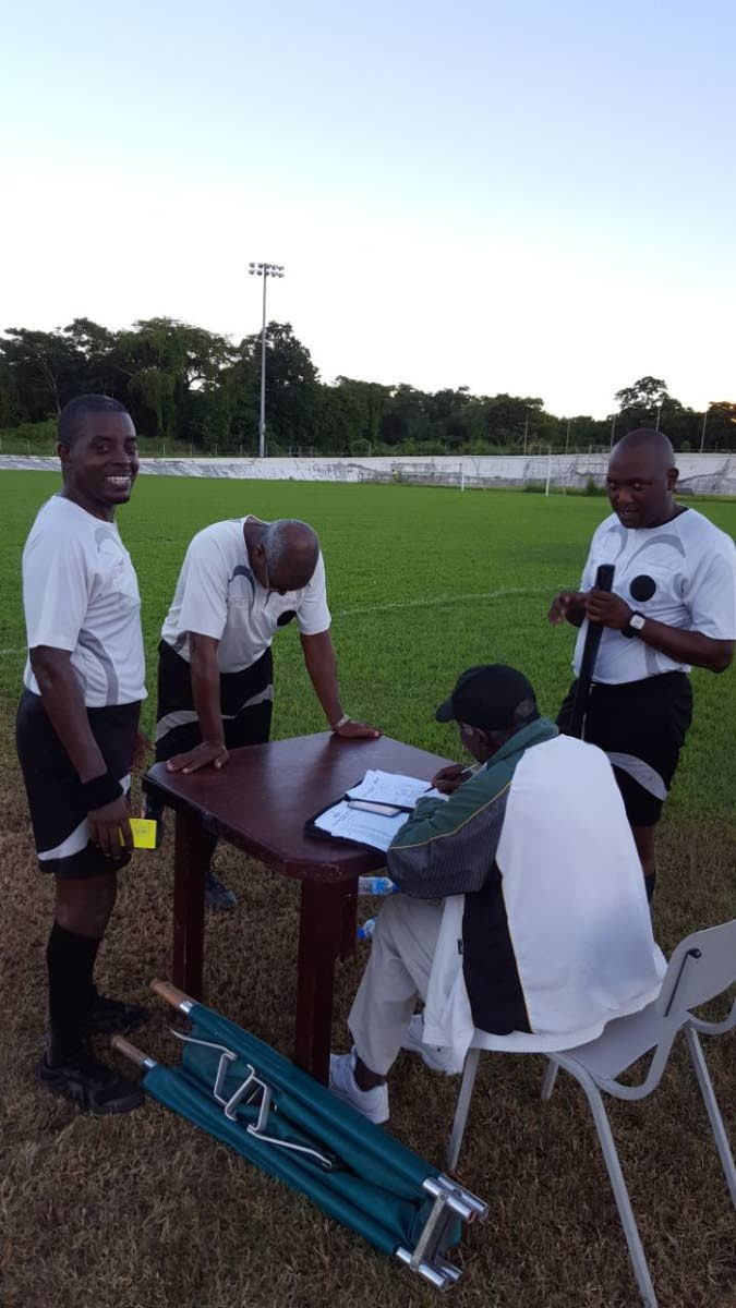 Head referee Roger Smith and his assistants Devon London and Junior Geoffrey at the Palo Seco Recreation Ground yesterday where they officiated the FC Santa Rosa vs Siparia Spurs game. PHOTO BY NICKOLAI MADRAY