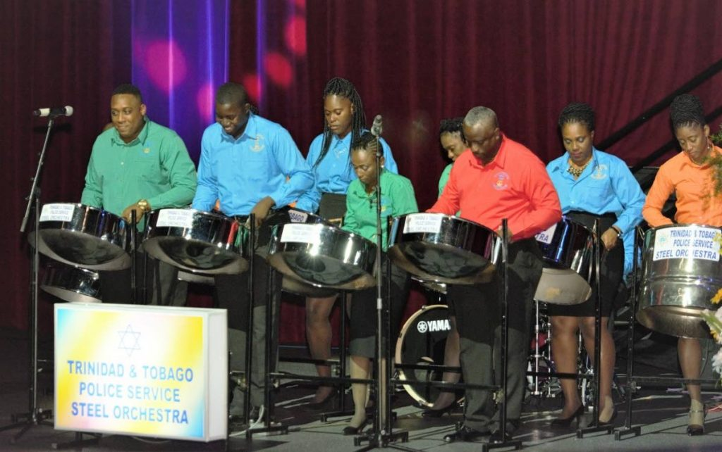 """Members of the TT Police Service Steel Orchestra perform at the """"It Takes a Village"""" variety concert at the Shaw Park Cultural Complex on Saturday night. The concert was hosted by the Police Service."""