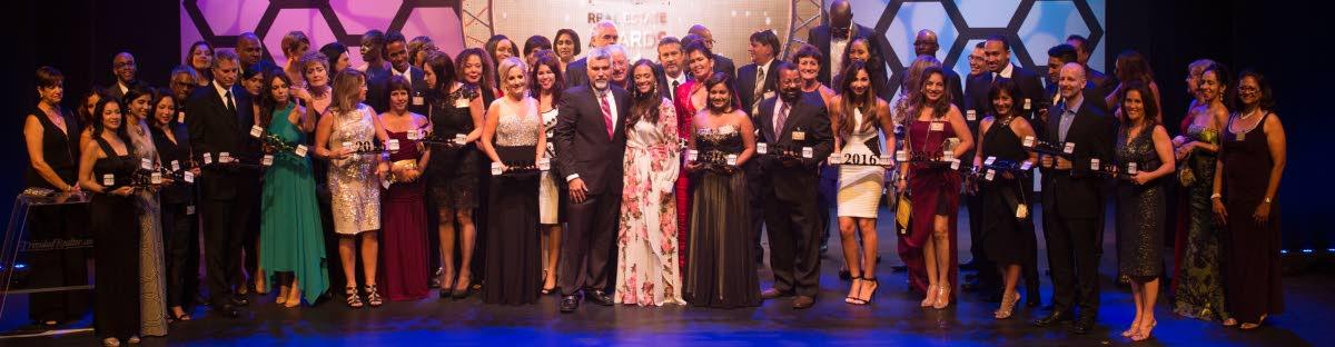 TrinidadRealtor.com owners Shane Correia and wife Chef Sascha Headley-Correia (centre) pose with 2016 winners