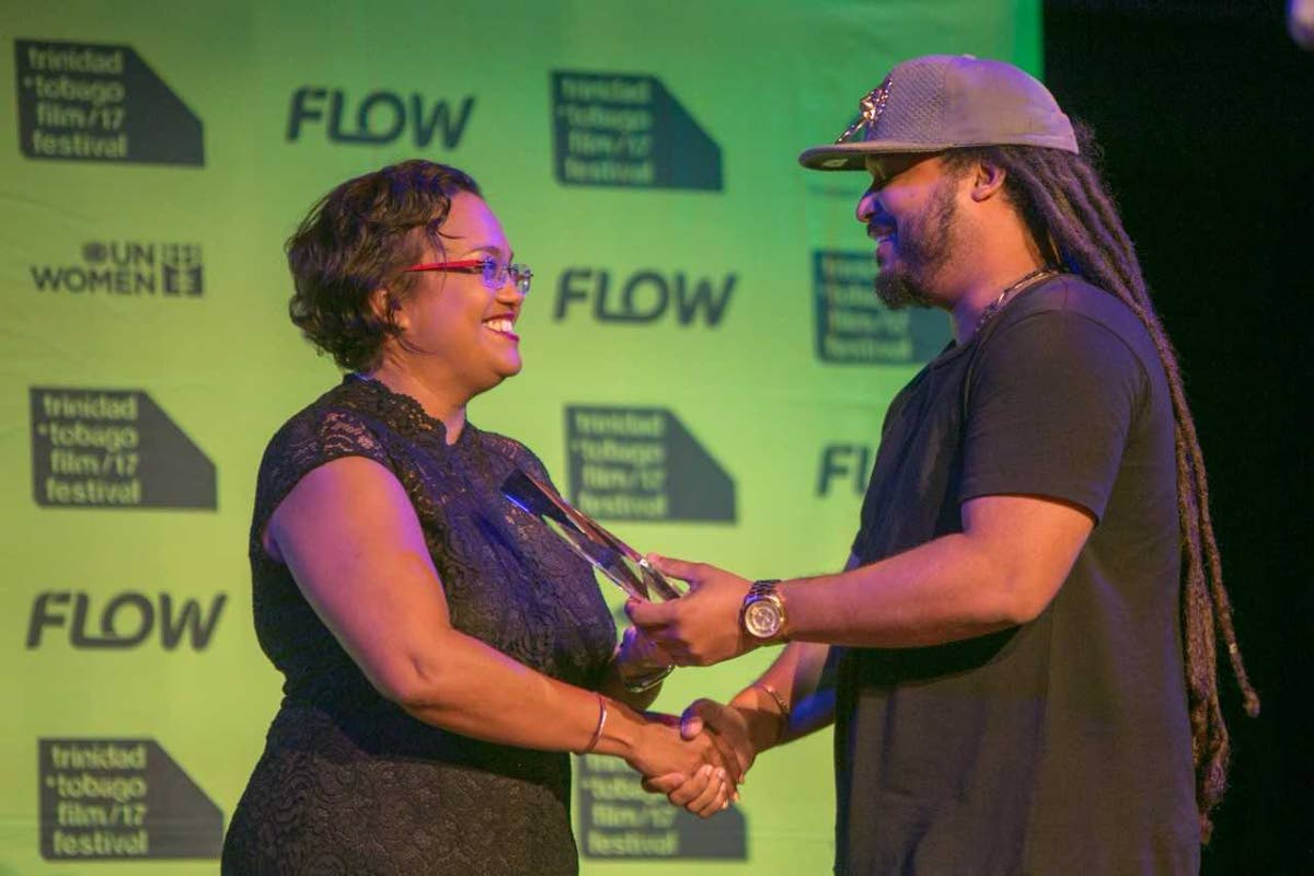 Cindy Ann Galt presents award to Green Days By the River director Michael Mooledhar during the Trinidad and Tobago Film Festival in September.