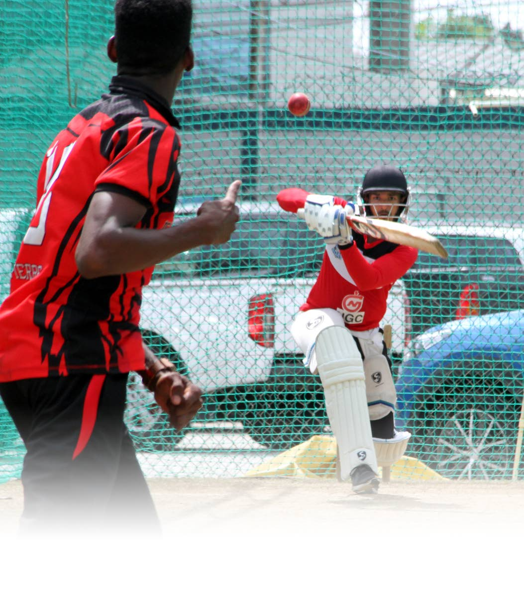 Red Force batsman Amir Jangoo hits a shot during a training session last month at the Queen's Park Oval, St Clair.