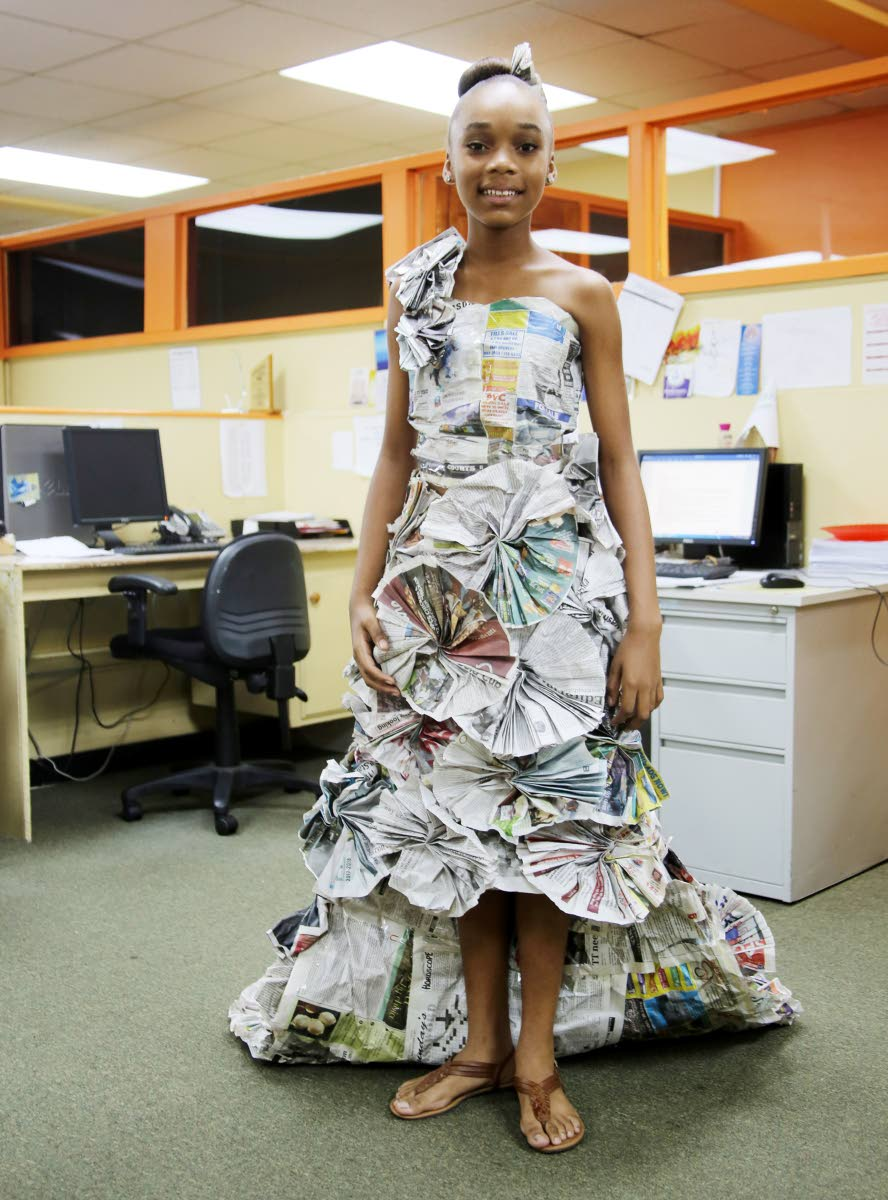 Print fashion: Xolani James,  a student of San Fernando Central Government Secondary, models her one-shoulder dress made out of Newsday newspapers at our Carlton Centre, San Fernando office on November 28. The dress was designed for a school project. Photos by Vashti Singh
